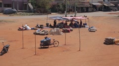 Indian people staying under a tent in India Stock Footage