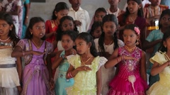 Indian girls praying and reciting in India - stock footage