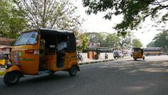 Indian tuk-tuks (rickshaws) on the streets of Chennai Stock Footage