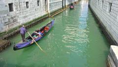 4k Tourists on gondola ride at canel near Doge palace Stock Footage