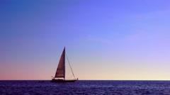 Sailboat at sunset Stock Footage