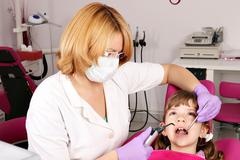 Little girl patient and dentist Stock Photos