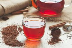 Traditional organic rooibos tea in rustic style with faded instagram filter - stock photo