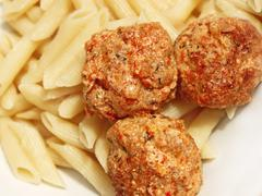 Stock Photo of Three meatballs with sauce over pasta
