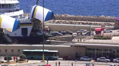 Stock Video Footage of MGARR, MALTA - Uploading trucks and cars from Ferry on Gozo