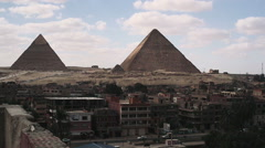 Giza Pyramids with city in the foreground - stock footage