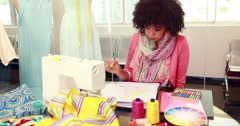 Attractive female fashion designer drawing at work Stock Footage