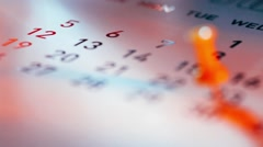 Rack focus of Push pin on a calendar Stock Footage