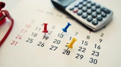 Dolly shot Push pin on a calendar Stock Footage