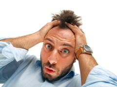 Stressed man tear his hair out - stock photo