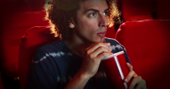 Young man watching a movie Stock Footage