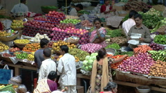 People buying fruits and vegetables on market in Goa, India Stock Footage