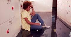 Depressed student sitting on the floor Stock Footage