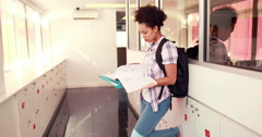 Pretty student revising and smiling at camera with thumbs up Stock Footage