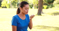 Woman using her inhaler Stock Footage