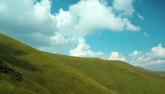 Time lapse of clouds in beautiful green mountains - stock footage