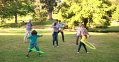 Stock Video Footage of Extended family playing with hula hoops