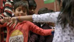 Varanasi, India, Republic Day, 26 January. Dancing children and flags. Stock Footage