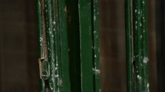 Chains and padlock old metal doors closing a business Stock Footage