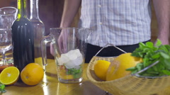 Man making cold sangria slow motion Stock Footage