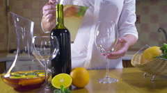 Woman pouring cold sangria in a glass slow motion Stock Footage