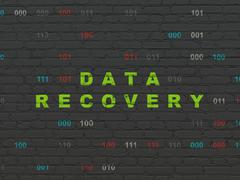 Stock Illustration of Information concept: Data Recovery on wall background