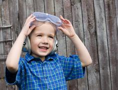 Little boy with safety glasses - stock photo