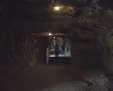 Tourists in a carved tunnel of the Bock casemates, which can be freely wandered Stock Footage