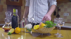 Man squeezing grapefruit for sangria slow motion Stock Footage