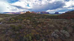 Aerial footage of Red Rocks and residential neighborhoods in Sedona, Arizona Stock Footage