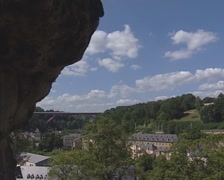 View from the Bock casemates at the Kirchberg plateau + pan + tilt up rock Stock Footage
