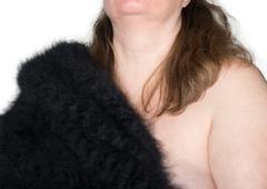 Beautiful woman with a black angora - stock photo