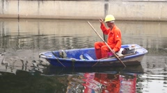 Sanitation workers to clean up the river rubbish Stock Footage