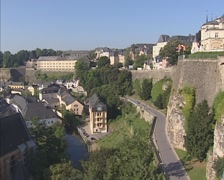 View from Bock Rock at old city quarter of Grund + tilt up ramparts + Corniche - stock footage