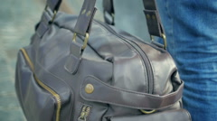 Man in jeans carries a bag Stock Footage