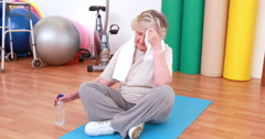 Tired senior woman on exercise mat Stock Footage