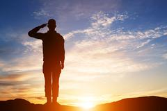 Soldier salute. Silhouette on sunset sky. Army, military. - stock illustration