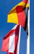 Two flags are fluttering in the wind - stock photo