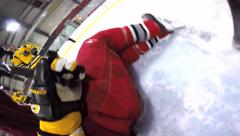 Helmet cam hockey player diving into net to keep puck out Stock Footage
