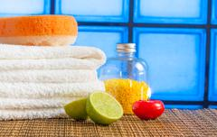 Spa massage border background with towel stacked red candle stone and lime Stock Photos