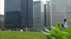 Business City District. People Walking on the background of skyscrapers - stock footage