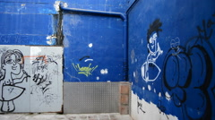 Zone have been abandoned with graffiti on the walls - stock footage