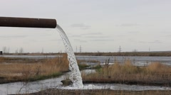 Clear water leaking from old industrial pipe Stock Footage