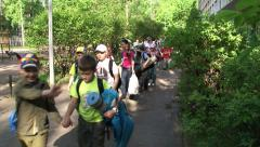 School children with parents going on a trip, HD Stock Footage