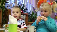 Little boy and girl drinking tea in kindergarten, Close-up - stock footage
