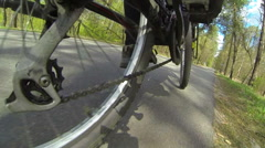 cyclist does turn.POV clip in spring day Stock Footage
