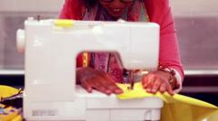 Fashion designer using sewing machine Stock Footage