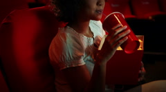Engrossed young woman watching a movie Stock Footage