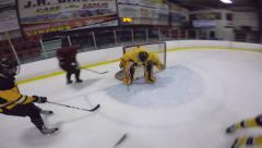 Hockey helmet cam of goalie stopping puck on the line Stock Footage