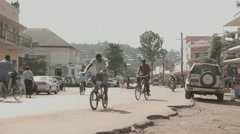 Tanzania Bukoba street bicycles motorbikes city Stock Footage